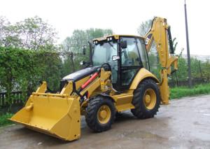 Traktor-bagr CAT 428E